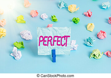 Handwriting text Perfect. Concept meaning complete without defects or blemishes precisely accurate or exact Colored crumpled papers empty reminder blue floor background clothespin.