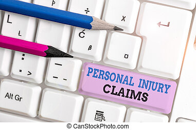 Handwriting text Personal Injury Claims. Concept meaning being hurt or injured inside work environment White pc keyboard with empty note paper above white background key copy space.