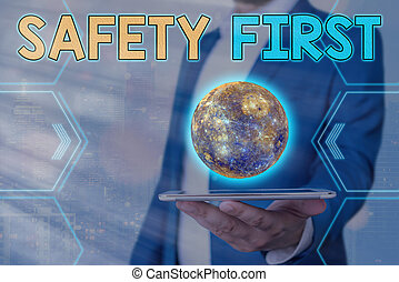 Handwriting text Safety First. Concept meaning used to say that the most important thing is to be safe Elements of this image furnished by NASA.
