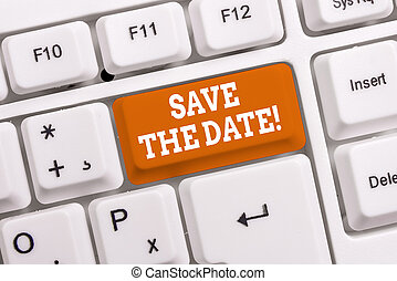 Handwriting text Save The Date. Concept meaning remember not schedule anything else on this day White pc keyboard with empty note paper above white background key copy space.