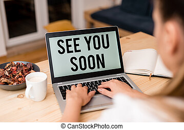 Handwriting text See You Soon. Conceptual photo used for saying goodbye to someone and going to meet again soon woman laptop computer smartphone mug office supplies technological devices