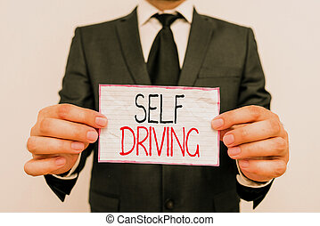 Handwriting text Self Driving. Concept meaning Autonomous ...