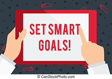Handwriting text Set Smart Goals. Concept meaning list to clarify your ideas focus efforts use time wisely Businessman Hand Holding, Pointing and Touching Colorful Tablet Blank Screen.