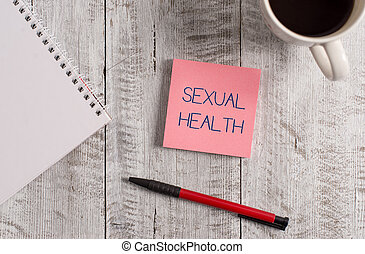 Handwriting text Sexual Health. Conceptual photo positive and respectful approach to sexual relationships Stationary placed next to a cup of black coffee above the wooden table