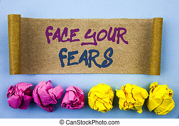 Handwriting text showing Face Your Fears. Concept meaning Challenge Fear Fourage Confidence Brave Bravery written on tear sticky note Paper on the blue background Folded paper