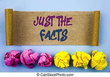 Handwriting text showing Just The Facts. Concept meaning Truth Fact Accuracy Honest Concept For Factual Actual written tear sticky note Paper the blue background Folded paper