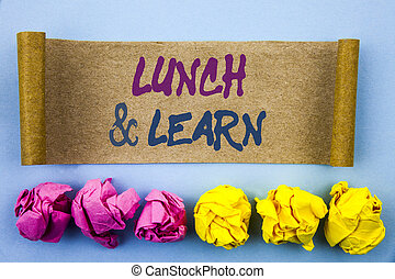 Handwriting text showing Lunch And Learn. Concept meaning Presentation Training Board Course written on tear sticky note Paper on the blue background Folded paper