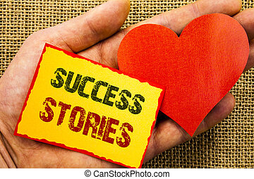 Handwriting text showing Success Stories. Business concept for Successful Inspiration Achievement Education Growth written on Sticky Note Paper With Heart Holding Hand with Finger.