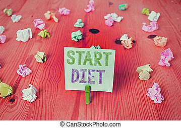 Handwriting text Start Diet. Concept meaning the practice of eating food in a regulated and supervised fashion Colored crumpled rectangle shaped reminder paper light blue background.