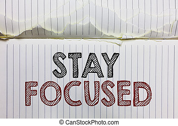 Handwriting text Stay Focused. Concept meaning Be attentive Concentrate Prioritize the task Avoid distractions Open notebook page crumpled papers ripped pages several tries mistakes.