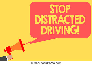 Handwriting text Stop Distracted Driving. Concept meaning asking to be careful behind wheel drive slowly Man holding megaphone loudspeaker speech bubble message speaking loud.