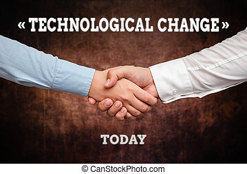 Handwriting text Technological Change. Word Written on increase in the efficiency of a product or process Two Professional Well-Dressed Corporate Businessmen Handshake Indoors