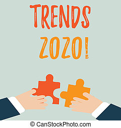 Handwriting text Trends 2020. Concept meaning general direction in which something is developing or changing Two Hands Holding Colorful Jigsaw Puzzle Pieces about to Interlock the Tiles.