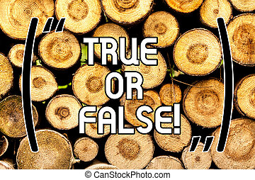 Handwriting text True Or False. Concept meaning Decide between a fact or telling a lie Doubt confusion Wooden background vintage wood wild message ideas intentions thoughts.