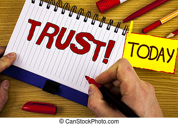 Handwriting text Trust Motivational Call. Concept meaning Belief in the Reliability Truth Ability Confidence written by Marker in Hand on Notebook on wooden background Today Pen Pencil next to it