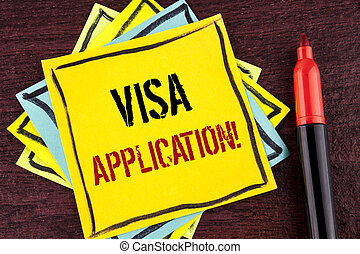 Handwriting text Visa Application Motivational Call. Concept meaning sheet to provide your basic information written on Yellow Sticky note paper on wooden background Marker next to it.