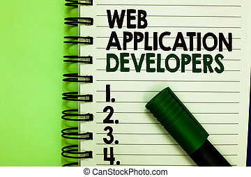 Handwriting text Web Application Developers. Concept meaning Internet programming experts Technology software Written letters and numbers on notepad laid green marker green back.