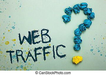 Handwriting text Web Traffic. Concept meaning Amount of data sent and received by visitors to a website Crumpled papers forming question mark several tries unanswered doubt.