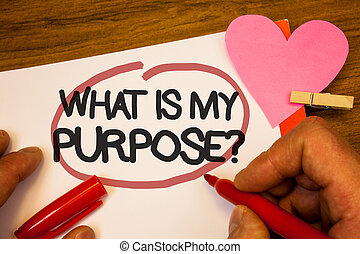 Handwriting text What Is My Purpose Question. Concept meaning Direction Importance Discernment Reflection Human hand retain red pen circled black words paper hook rivet pink heart.