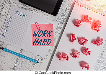 Handwriting text Work Hard. Conceptual photo Laboring that puts effort into doing and completing tasks Squared spiral notebook marker smartphone paper balls note clip wooden