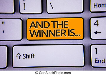 Handwriting text writing And The Winner Is . Concept meaning Announcing as first place in competition or race Silver color polished modern computer keyboard with yellow arrow button.