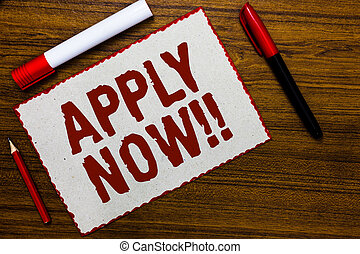 Handwriting text writing Apply Now. Concept meaning Make a formal application for a job right away Take action White paper red borders markers wooden background communicating ideas.