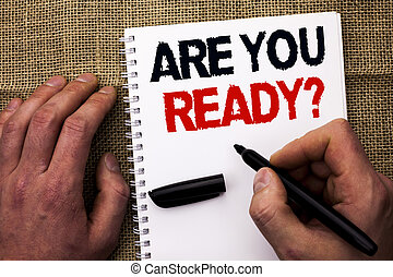 Handwriting text writing Are You Ready Question. Concept meaning Be Prepared Motivated Warned Readiness Aware written by Man Holding Marker Notebook Book the jute background.