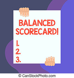 Handwriting text writing Balanced Scorecard. Concept meaning a perforanalysisce metric used in strategic analysisagement Two hands hold one big empty blank white paper placed on top and bottom.