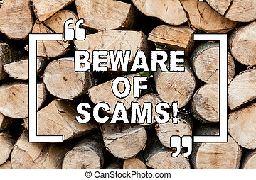 Handwriting text writing Beware Of Scams. Concept meaning Stay alert to avoid fraud caution be always safe security Wooden background vintage wood wild message ideas intentions thoughts.