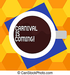Handwriting text writing Carnival Is Coming. Concept meaning public festival which showing play music and dance Top View of Drinking Cup Filled with Beverage on Color Paper photo.