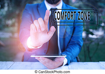 Handwriting text writing Comfort Zone. Conceptual photo place or situation where one feels safe and without stress Businessman with pointing finger in front of him