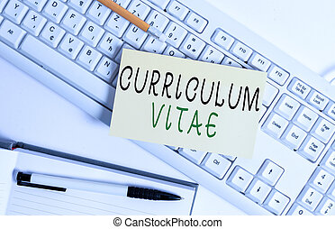 Handwriting text writing Curriculum Vitae. Concept meaning overview of an individual qualifications for job opportunity White keyboard with note paper and clips on white background.