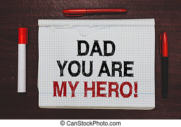 Handwriting text writing Dad You Are My Hero. Concept meaning Admiration for your father love feelings compliment Written black, red words notepad on brown stage white highlighter red pens.