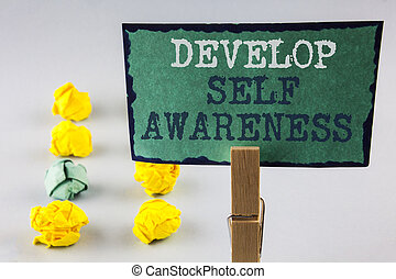 Handwriting text writing Develop Self Awareness. Concept meaning improve your Informations about surrounding events written on Sticky Note Paper holding by Clip plain background Paper Balls