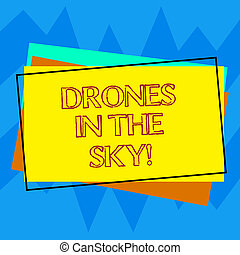 Handwriting text writing Drones In The Sky. Concept meaning Aerial helicopter modern device taking pictures and video Pile of Blank Rectangular Outlined Different Color Construction Paper.