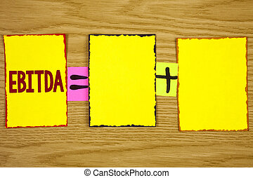 Handwriting text writing Ebitda. Concept meaning Earnings before tax is measured to evaluate company performance written on Sticky Note Paper on wooden background. Equation with Plus sign.