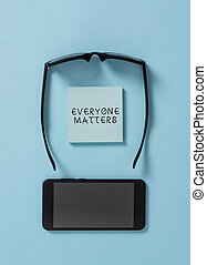 Handwriting text writing Everyone Matters. Concept meaning all the showing have right to get dignity and respect Dark eyeglasses colored sticky note smartphone fashion pastel background.