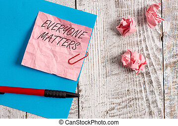 Handwriting text writing Everyone Matters. Concept meaning all the showing have right to get dignity and respect Wrinkle paper and cardboard plus stationary placed above wooden background.
