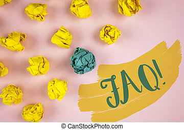 Handwriting text writing Faq Motivational Call. Concept meaning Frequently asked question for clearing up confusions written on Painted background Crumpled Paper Balls next to it.