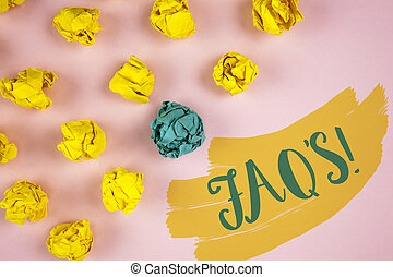 Handwriting text writing Faq'S Motivational Call. Concept meaning Multiple questions answered for online product written on Painted background Crumpled Paper Balls next to it.