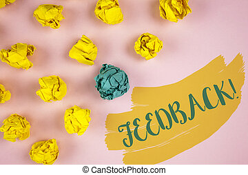 Handwriting text writing Feedback Motivational Call. Concept meaning Rating an economical local grocery store written on Painted background Crumpled Paper Balls next to it.