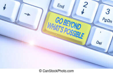 Handwriting text writing Go Beyond What S Possible. Concept meaning do bigger things You can reach dreams White pc keyboard with empty note paper above white background key copy space.
