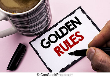 Handwriting text writing Golden Rules. Concept meaning Regulation Principles Core Purpose Plan Norm Policy Statement written by Man Sticky Note paper holding Marker plain background Coffee Cup
