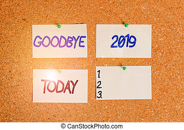 Handwriting text writing Goodbye 2019. Concept meaning expressing good wishes during parting at the end of the year Corkboard color size paper pin thumbtack tack sheet billboard notice board.