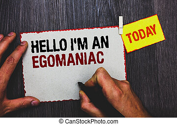 Handwriting text writing Hello I am An Egomaniac. Concept meaning Selfish Egocentric Narcissist Self-centered Ego Hand grip black marker writing text paperclip stick written page woody deck.