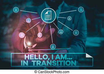 Handwriting text writing Hello I Am In Transition. Concept meaning Changing process Progressing planning new things Male human wear formal work suit presenting presentation using smart device.