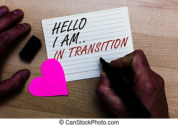Handwriting text writing Hello I Am.. In Transition. Concept meaning Changing process Progressing planning new things Written on notepad hand hold marker with love heart wooden background.