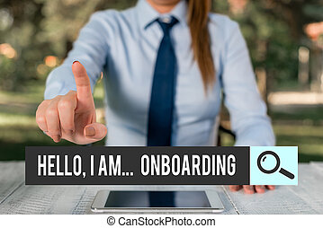 Handwriting text writing Hello I Am Onboarding. Concept meaning telling demonstrating that you are on ship or plane Female business person sitting by table and holding mobile phone.