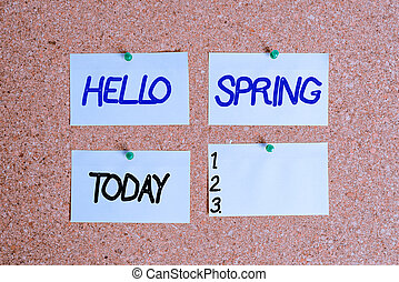 Handwriting text writing Hello Spring. Concept meaning welcoming the season of the blossoming of flowers End of winter Corkboard color size paper pin thumbtack tack sheet billboard notice board.
