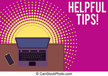 Handwriting text writing Helpful Tips. Concept meaning advices given to be helpful knowledge in life Upper view office working place laptop lying wooden desk smartphone side.